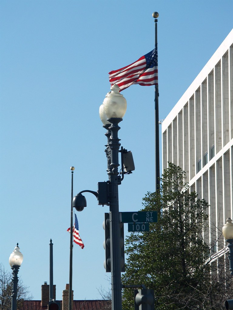 Surveillance Camera Under American Flags At The Corner Of C Street, NE & Second Street, NE (Washington, DC)