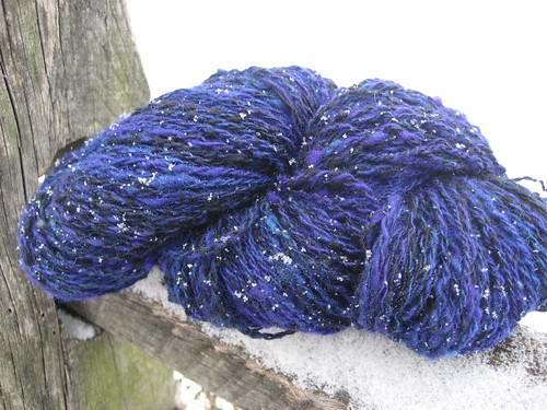 Blue yarn in snow