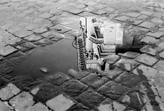 Neoclassical puddle (Nash72) Tags: road italy abstract rome roma architecture 50mm italia sanpietrini architettura sanrocco pozzanghere