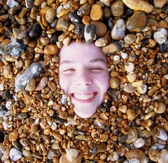 Stony Faced (floato) Tags: uk sea england copyright favorite color colour beach water smile face century happy this see coast photo interesting brighton foto fotograf photographer view photos buried britain picturesthroughholes unique hove tide side famous watch group 21st favorites pebbles spot best professional explore photograph fotos enjoy attractive favourites welcome exquisite fabulous favourite marvelous groups expert grouping favorited eyecatching favourited fotograph fotographer floato anawesomeshot superbmasterpiece pleaseaskifyouwanttouseaphotoiusuallysayyes