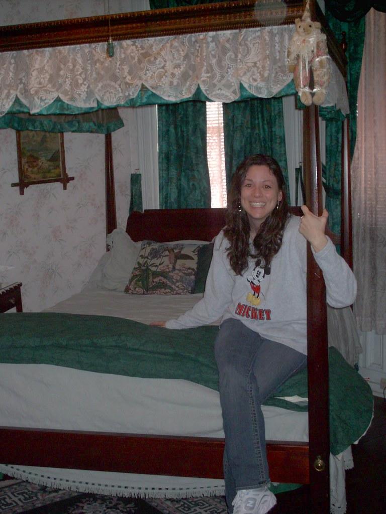 Jenn on 4 post bed at Rutledge Victorian B&B