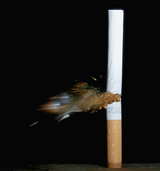 torn cigarette (Mark Watson (kalimistuk)) Tags: make speed lumix 22 frozen still shot cigarette flash ripped fast panasonic smokes mayfair kingsize tar highspeed nicotine fz50 strobes soundtriggerd