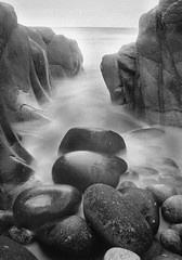 Time and Tide (*_rob) Tags: white seascape black robert film 35mm wow landscape coast long exposure cornwall time stones tide rob porth nanven cotcbestof2006 superaplus aplusphoto favemegroup13 ringrow robertringrow robringrow