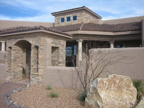 McMansions are out, like this one in what looks like the southwest