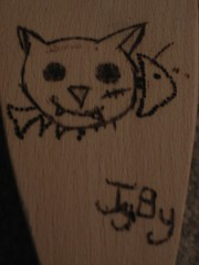 Crazy Cat burnt on wood