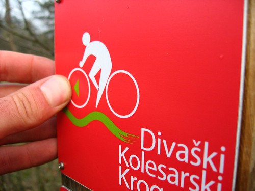 Microscopic bicycle route sign in Matavun, Slovenia