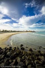 Alkout Beach - Kuwait (Khalid AlHaqqan) Tags: blue sea sky beach ex clouds way coast dc sand marine rocks tide sigma kuwait 1020mm khalid alkout f456 hsm kuwson alhaqqan