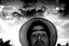 no tienen sino paja en la cabeza (javier.izquierdo) Tags: bw 15fav selfportrait me clouds geotagged puertorico autoretrato armslength nubes sombrero strawhat dorado javierizquierdo pr2007