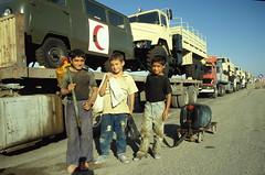 TRUCKING IN IRAQ (Claude  BARUTEL) Tags: red boys iraq crescent uaz