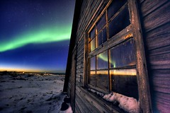 Northern Window (hoskarsson) Tags: wood sky snow reflection window topf25 stars iceland topf50 topf75 reykjavik aurora topf100 northernlights polarlights northernlight supershot aroraborealis abigfave colorphotoaward 200750plusfaves goldenphotographer auroralights halldorornoskarsson