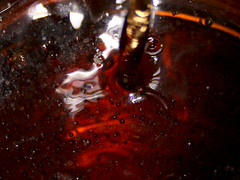 Pouring Coke (Janmi_) Tags: black macro dark drink bubbles coke cocacola pour softdrinks oneonone 1on1macros 1on1macrosphotooftheday superbmasterpiece 1on1macrosphotoofthedaymar2007