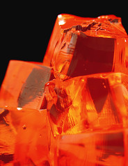 Fire Cubes (Furryscaly) Tags: red food orange color colour macro wet yellow closeup blackbackground contrast catchycolors dessert fire juicy shiny colorful warm dof pyramid squares highcontrast jiggly stack depthoffield pile snack refraction treat cubes colourful jello fruity stacked cubed firey flavored piled gelatin warmcolors impressedbeauty theresalwaysroomforjello colourlicious simplyyourbest orangejello orangegelatin