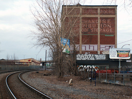 The Van Horne Warehouse, at the corner of Van Horne and the Main, is not  only covered with ghost signs and graffiti, it is capped by a water tower,  ...