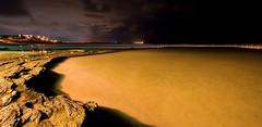 Cronulla Beach tidal pool. (Daniel Speranza) Tags: longexposure water pool rain weather yellow clouds lights sand rocks purple nightshot handrail shallow canon30d abigfave 1022mmf3545usm