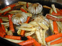 Roasted carrots and parsnips with a few heads of garlic