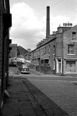 Halifax, Yorkshire, 1972. (Fray Bentos) Tags: chimney industry yorkshire halifax terracedhousing westriding