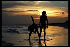 Childhood (Augusto Miranda Martins) Tags: ocean sunset sea brazil sky people water nova silhouette brasil kids d50 nikon dusk bahia viçosa