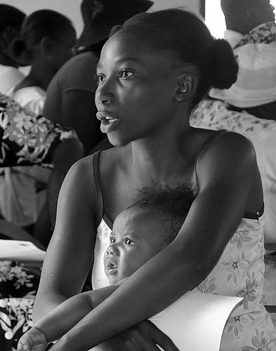 Beautiful Haitian woman with child by audra k..
