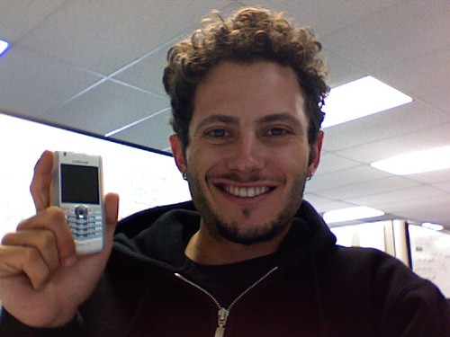 noah kagan afro with blackberry pearl phone