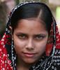 Bangla girl with the Mona Lisa smile (Greg Miles) Tags: blue people green eye beauty asian eyes desi eyed bangladesh bengali bangladeshi superbmasterpiece banglagirl
