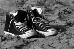 All Star on the Beach (Orest (AKA Mugnu)) Tags: italy rome roma beach blackwhite seaside interesting italia sneakers allstar ostia 1000views converseallstar 10faves abigfave flickraward mugnu somebodyshoes orestedicaterino flickrphotoaward