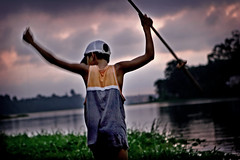 The big catch... (carf) Tags: poverty light boy sunset brazil lake reflection boys water brasil kids dark children hope kid fishing community support paradise child risk darkness sundown naturallight forsakenpeople esperana social impoverished underprivileged altruism eldorado reservoir haunting development prevention billings atrisk mundouno impressedbeauty cleison