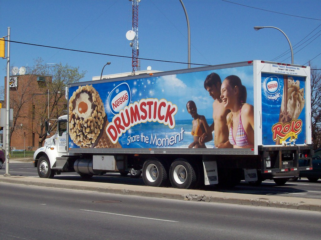 A refrigerated truck advertising Nestlé Drumstick and Rolo ice cream cones...