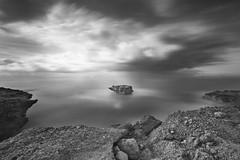 The rock (Rafael Díez) Tags: españa castellon alcoceber paisaje mar agua filtro largaexposición rafaeldíez rocas nubes blancoynegro