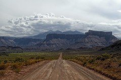 Down The Road (MalaneyStuff) Tags: moab utah road dirtroad mountains cloads d5100 nikon hwy128