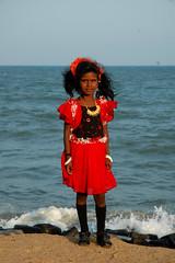 Girl in red dress, Pondicherry (spottedowlet) Tags: red india black beach girl socks hair gold south jewelry pondicherry bangles seaface florews blackribbonbeauty