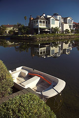 USA - California - Venice Beach Canals (Darrell Godliman) Tags: california ca travel venice copyright usa reflection travelling tourism strand america la boat us losangeles unitedstates unitedstatesofamerica transport playa canals northamerica venicebeach plage spiaggia allrightsreserved travelphotography  thestates 5photosaday omot travelphotographer dgphotos darrellgodliman wwwdgphotoscouk dgodliman