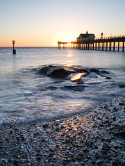 Southwold Pier at Sunrise (. Andrew Dunn .) Tags: uk longexposure sea england sun seascape beach sunrise landscape dawn pier suffolk seaside rocks surf britain pebbles southwold eastanglia interestingness234 i500 cy2 challengeyouwinner aplusphoto