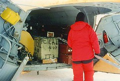 Loading up the cargo haul of the helicopter