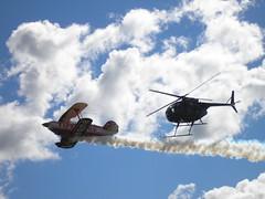 I'm right behind you! (Andrs Martn / Tincho) Tags: sky arm smoke helicopter cielo firestone humo nube avion helicoptero eaa andresito aerea pitts acrobacia hughes500 s2b malatini andresmartin andrsmartn