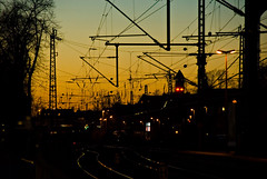 Sunset Bonn main station (manganite) Tags: trees winter sunset sky orange sun industry nature topf25 colors station yellow digital germany geotagged dawn evening interestingness nikon colorful europe bonn afternoon seasons searchthebest tl branches tracks silhouettes atmosphere railway explore wires getty wired onecolor d200 nikkor dslr gettyimages northrhinewestphalia interestingness29 i500 18200mmf3556 utatafeature manganite nikonstunninggallery ipernity thecolororange date:year=2007 geo:lat=50732559 geo:lon=7094749 date:month=march date:day=11
