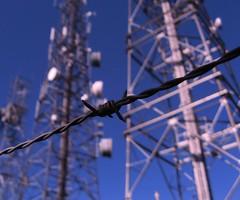 Barb (monkeyiron) Tags: sunshine radio scotland mast barbwire inverness msh0707 msh070711 piercingflesh