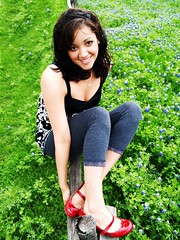 Sittin Pretty (kkelly2007) Tags: red portrait girl smile fence shoes laugh