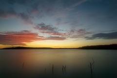 Quiet Sunset (denny.weinmann) Tags: clintonlake explore landscape photography rokinon sonyalpha sunset water kansas clouds lake mefoto rocks sonya6000 sonyimages travel