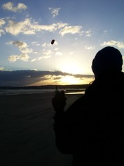 Jen flying her kite into the sunset