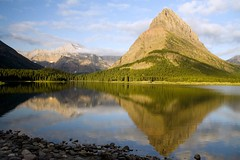 Morning at Swiftcurrent Lake (Robby Edwards) Tags: vacation mountain lake water clouds sunrise nationalpark bravo montana interestingness1 glacier glaciernationalpark swiftcurrentlake manyglacier specland specnature grinnellpoint abigfave mountgould impressedbeauty