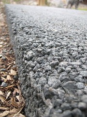 Pervious concrete edge (justsmartdesign) Tags: seattle park creek concrete washington pavement gi ravenna porous 3pp pervious views4000 greeninfrastructure porouspavement