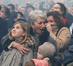 Watching the fireworks (Dean Ayres) Tags: people london scarf snuggle haze energy faces fireworks smoke coat watching dean documentary chinesenewyear leicestersquare westend huddle protect 2007 drift attica monza canon30d chinainlondon fivestarsgallery abigfave twtmeiconoftheday diamondclassphotographer artlibres foragecap chinalondon 1000cand