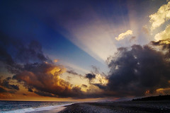Through the Clouds (fjny) Tags: sunset sea sky sunlight beach clouds taiwan explore rays   taidung 10faves justclouds skyiscreative mytop48