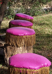pink vinyl upholstered tree stumps