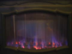 Winterwarmth (irriske) Tags: winter flames kachel warmth stove canonpowershota95 vlammen warmte irriske