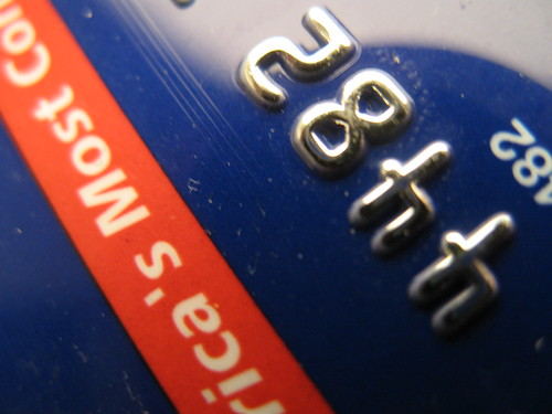 a close up of credit card numbers