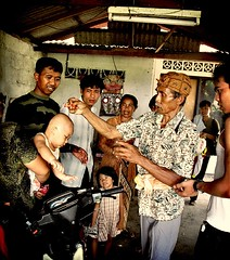 the blessing (~.charlie.~ ...) Tags: family bali children indonesia lomo asia prayer religion belief holy hindu nenek bapak memek kadek