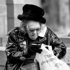 Hat with old lady (Rarohonda) Tags: hat boston oldpeople smoker plasticraincoat