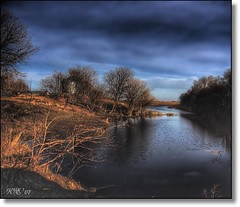 Lonely River (Wenspics) Tags: trees sky reflection water field topv111 rural river topv333 bravo scenery stones farm branches country ripples opt magicdonkey abigfave anawesomeshot superaplus aplusphoto superhearts gempics