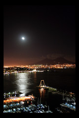 Magic Moon in Naples (! .  Angela Lobefaro . !) Tags: longexposure trip travel vacation sky italy panorama moon castle topf25 topv111 architecture night clouds reflections dark landscape volcano mond noche interestingness firefox topf50 topv333 exposure italia nuvole nightshot searchthebest nacht action quality topv1111 topv999 interestingness1 2006 luna bleu explore ciel nubes linux napoli handheld naples vesuvius moonlight 300views 500views schloss vesuvio frontpage ubuntu nuit castello notte allrightsreserved italians lluna kubuntu golfodinapoli mergellina topv300 magicdonkey 50faves topviews natuzzi naplesgulf holidaysvacanzeurlaub angiereal 200750plusfaves napolibynight angelamlobefaro napolinotte riproduzioneriservata